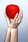 リンゴを掲げ持つ手